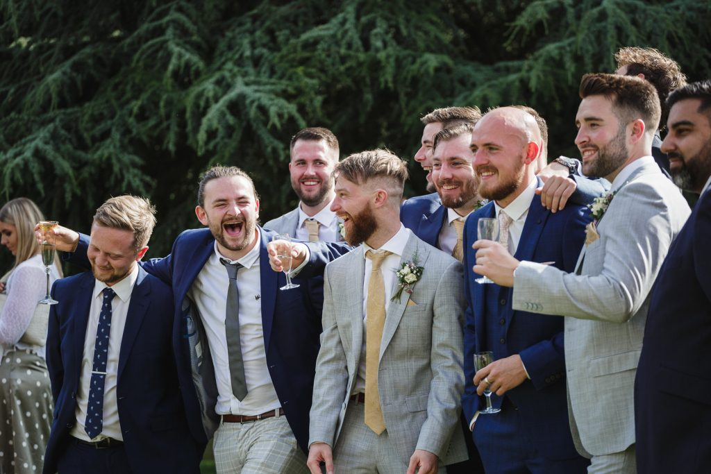 the groom's friends laughing