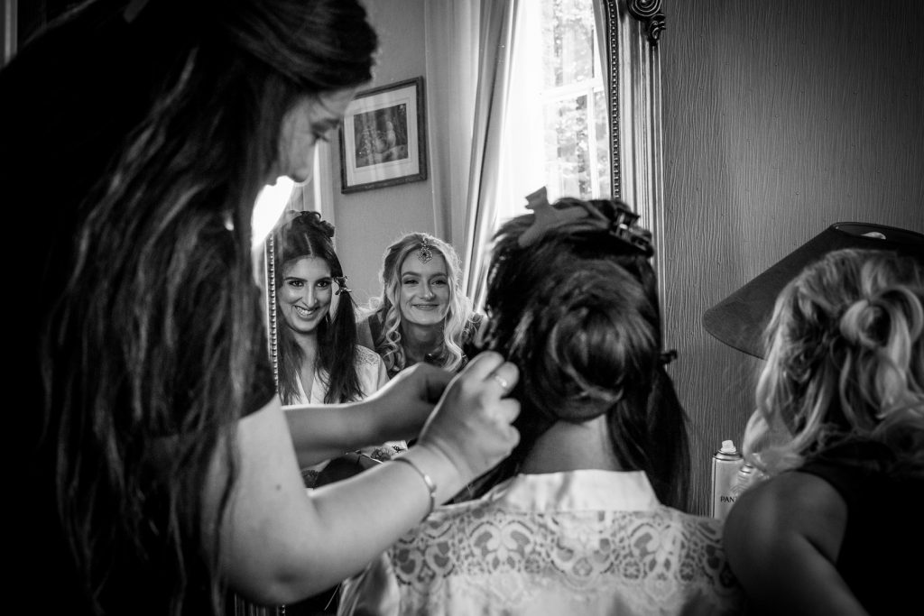 Black & White photo of bride and bridesmaid getting ready at Hilton Hall Wolverhampton