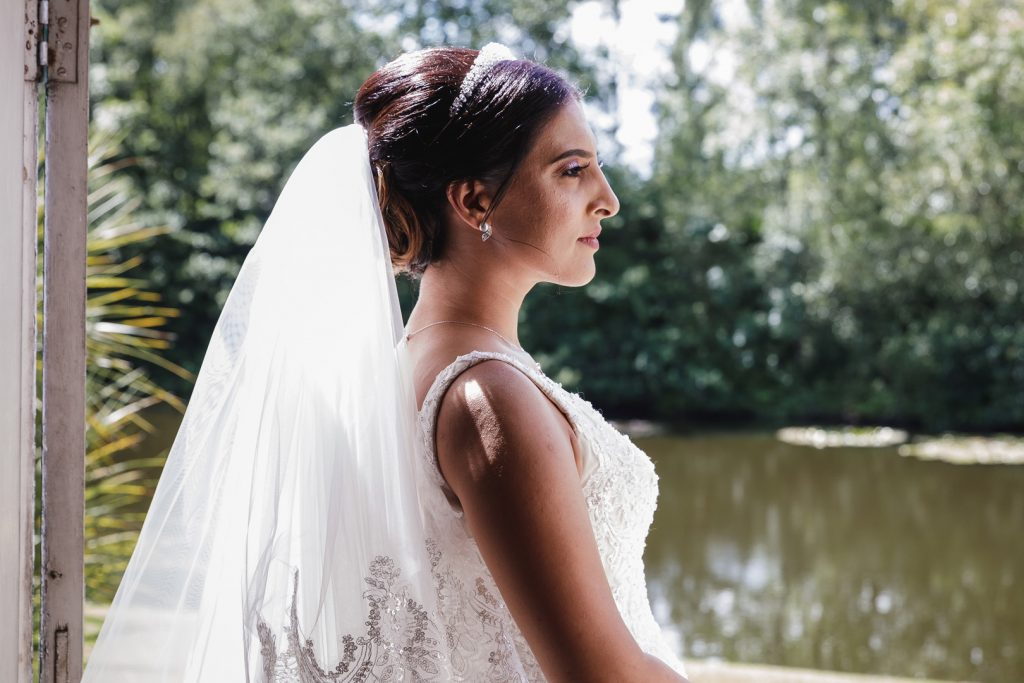 Bride overlooking the lake at Hilton Hall, Wolverhampton