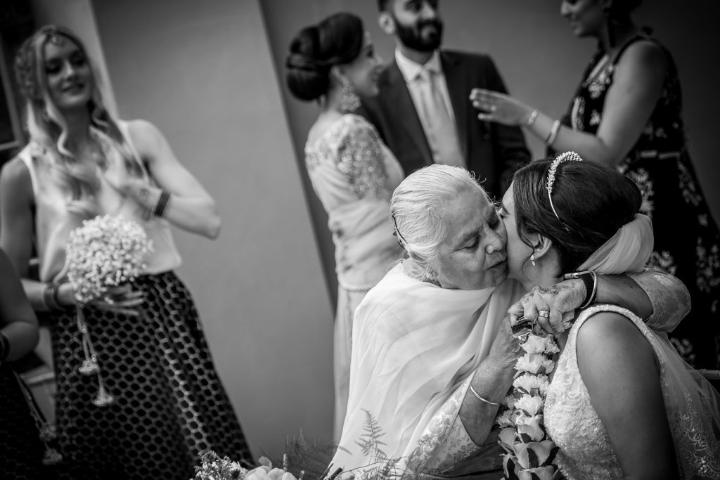 Emotional embrace of the bride from her grandmother