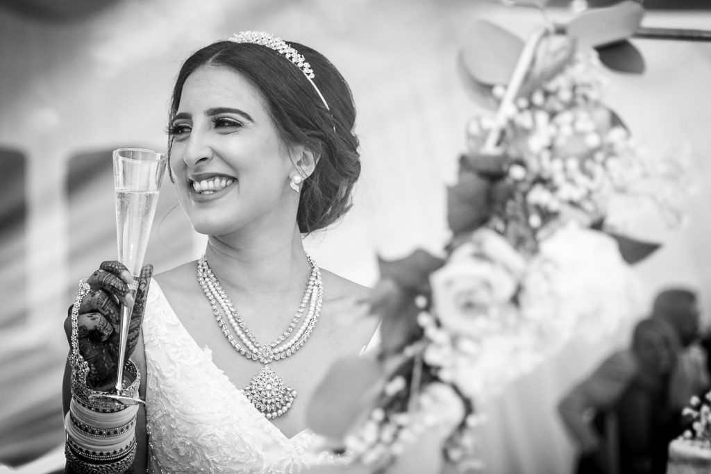 smiling bride with a glass of champagne