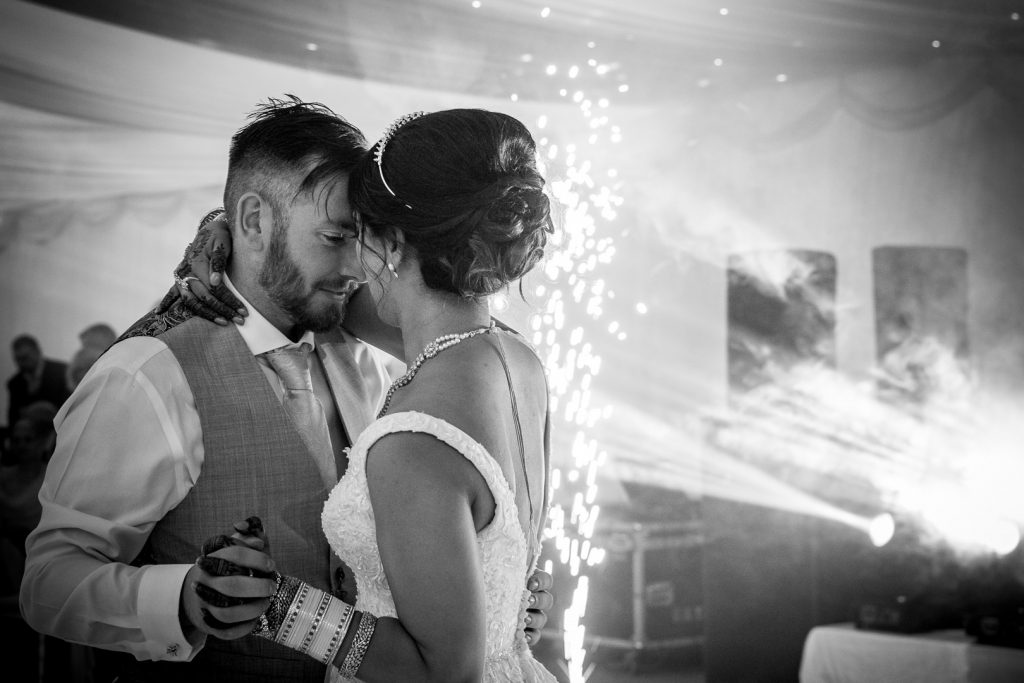 first dance with fireworks at Hilton Hall wedding