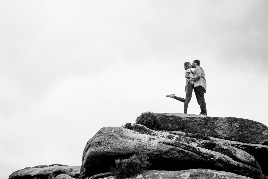 couple kiss on their peak district engagement shoot