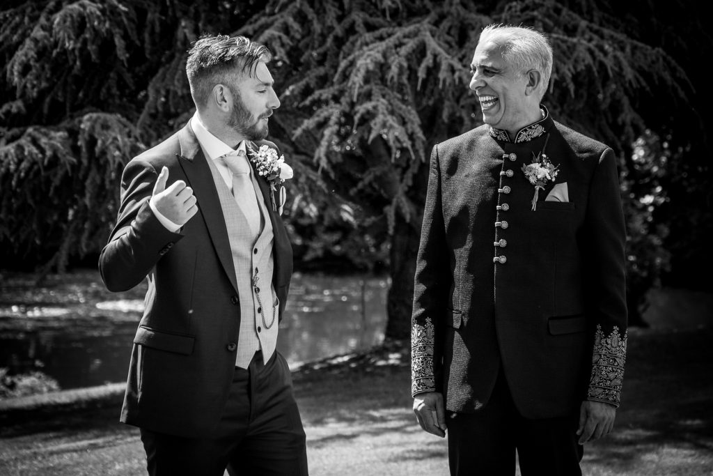 Groom and father of the bride laughing