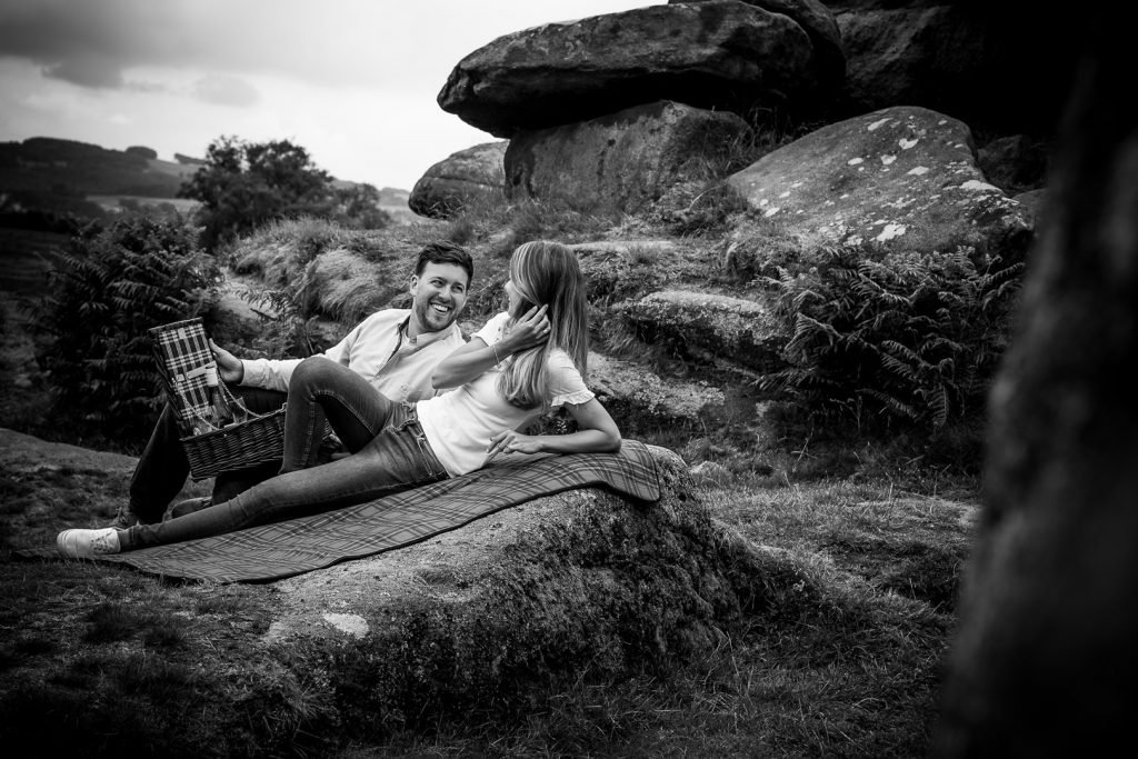 Laura & Rob enjoying wine from their hamper on their Peak District Engagement Shoot