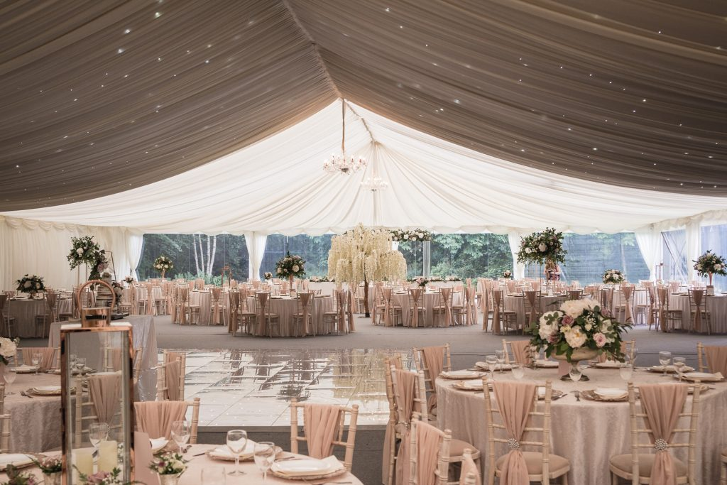 Marquee dressed for a wedding with blossom trees