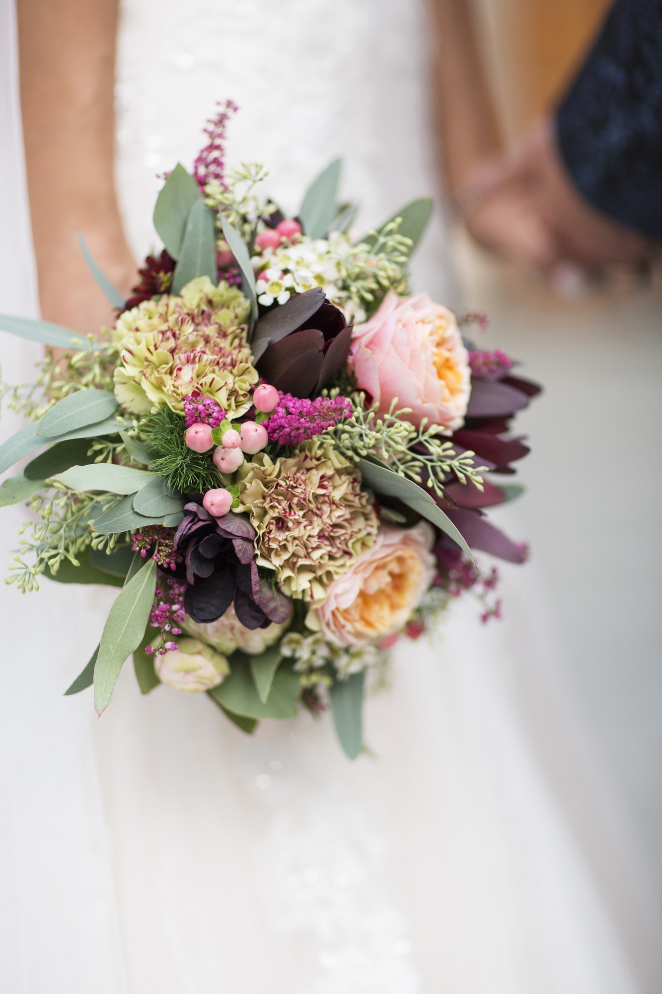 close up of a bouquet of fires in the hands of the bride 1.jpg