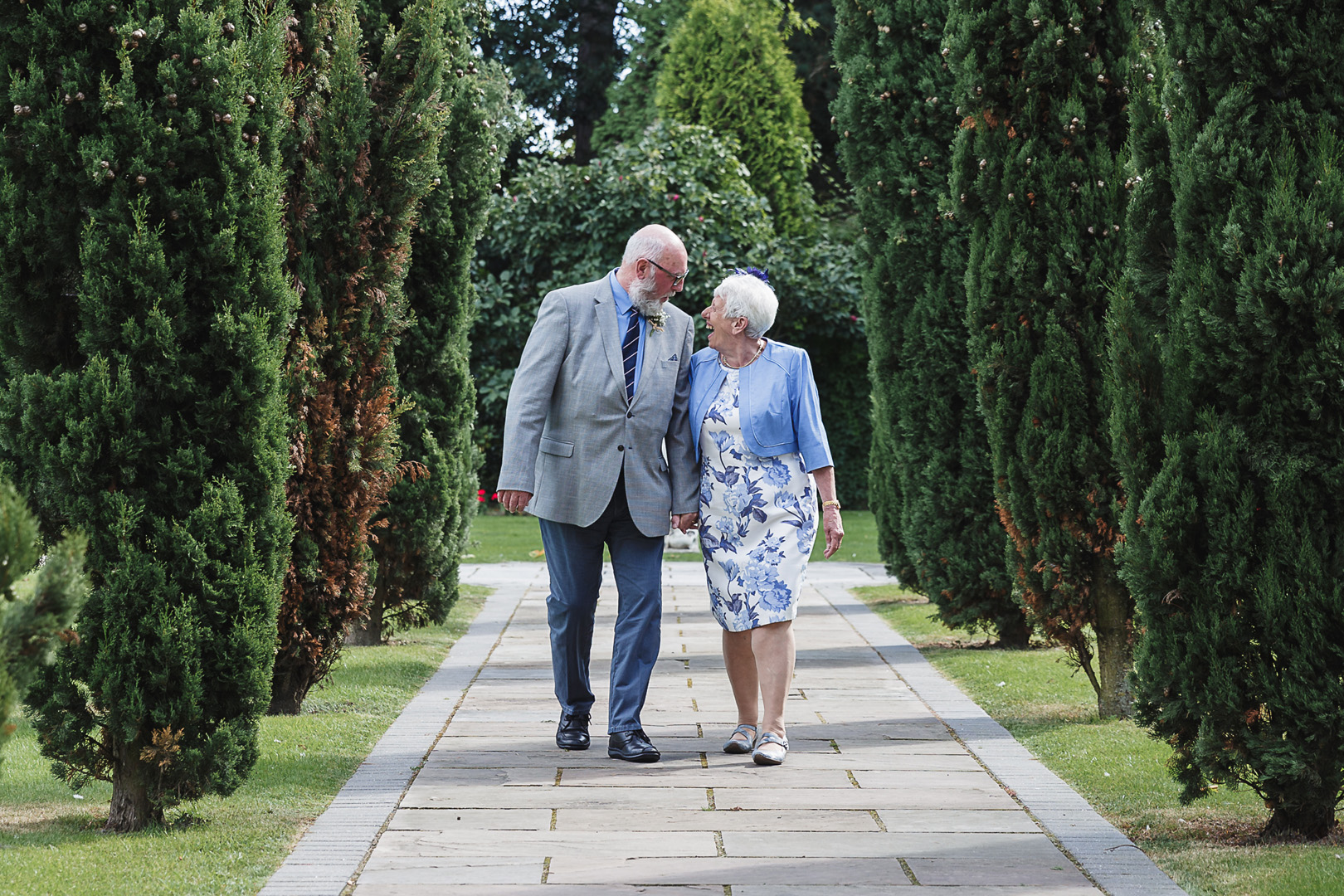 brides grandparents walking around the grounds at this west retford hotel wedding