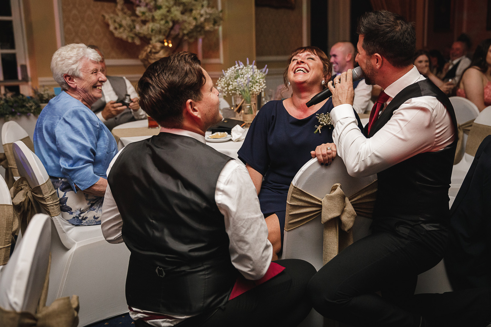 The Undercover Waiters serenading the brides mum at west retford hotel wedding