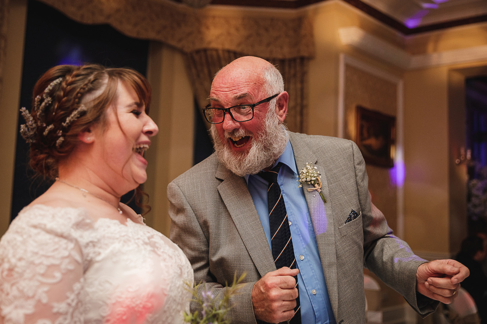 bride and her grandfather laughing