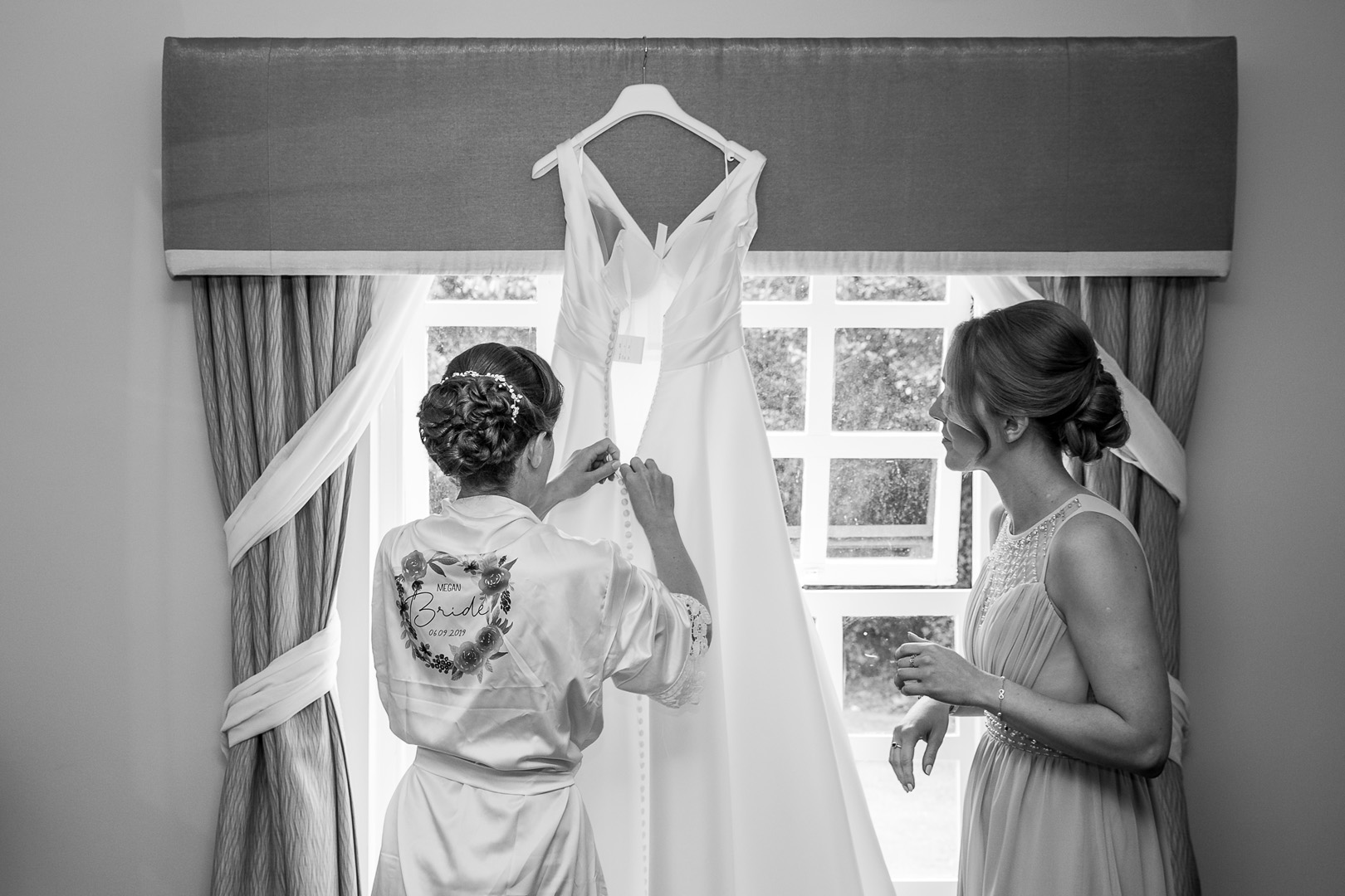 Bride unbuttoning her dress at this west retford hotel wedding