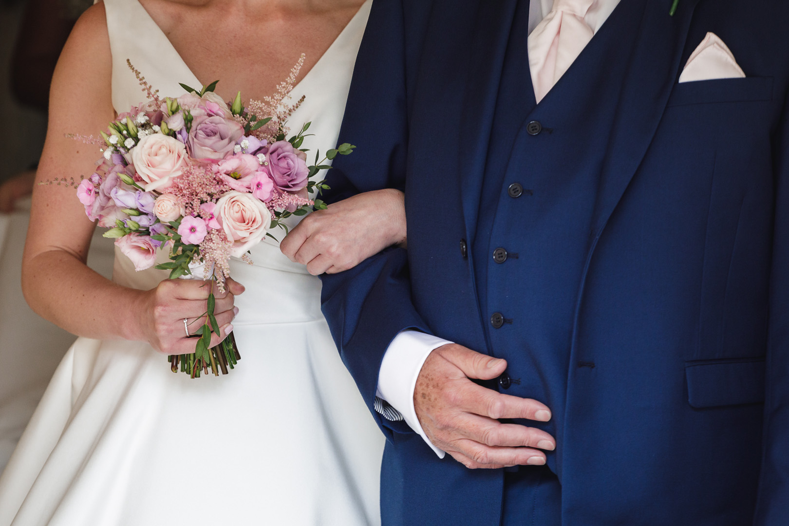 Bride and father linking arms before her west retford hotel wedding