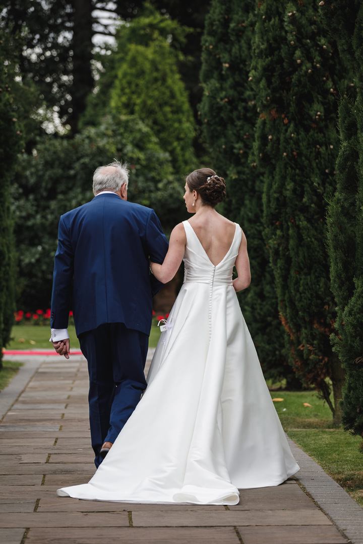 The bride and father walking down the aisle at this west retford hotel wedding