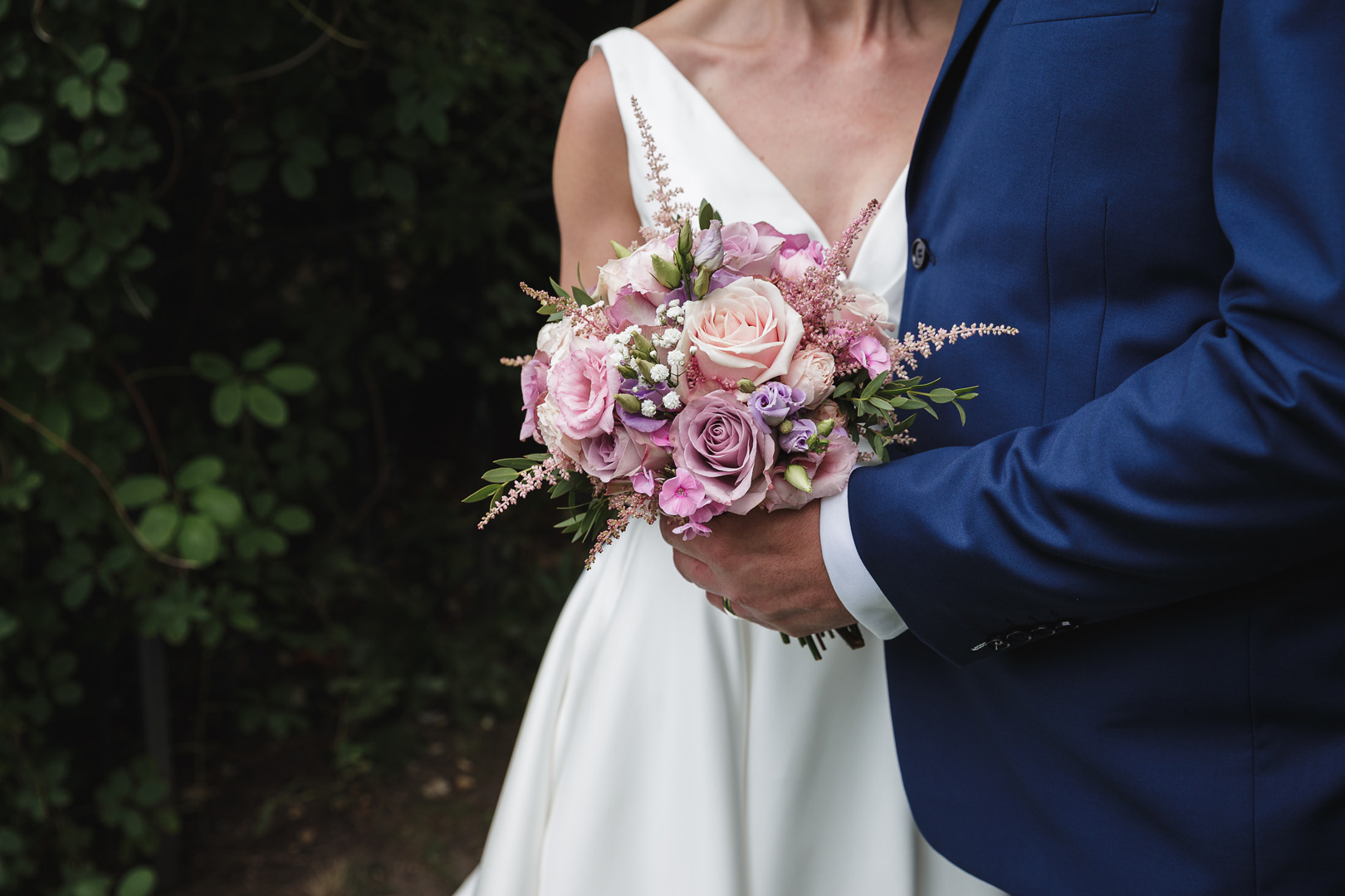 Bride's bouquet held by groom