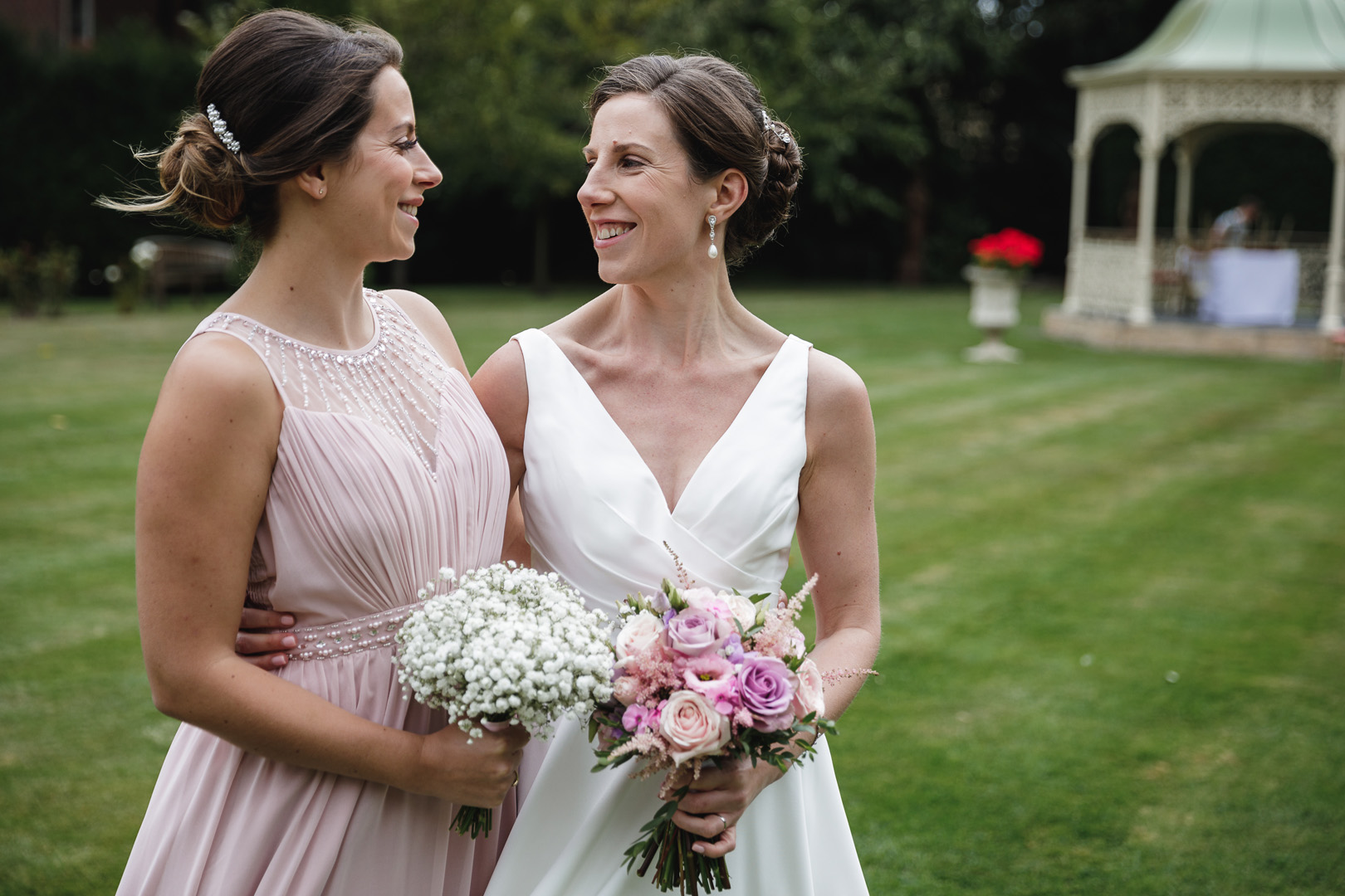 Bride and bridesmaid smiling