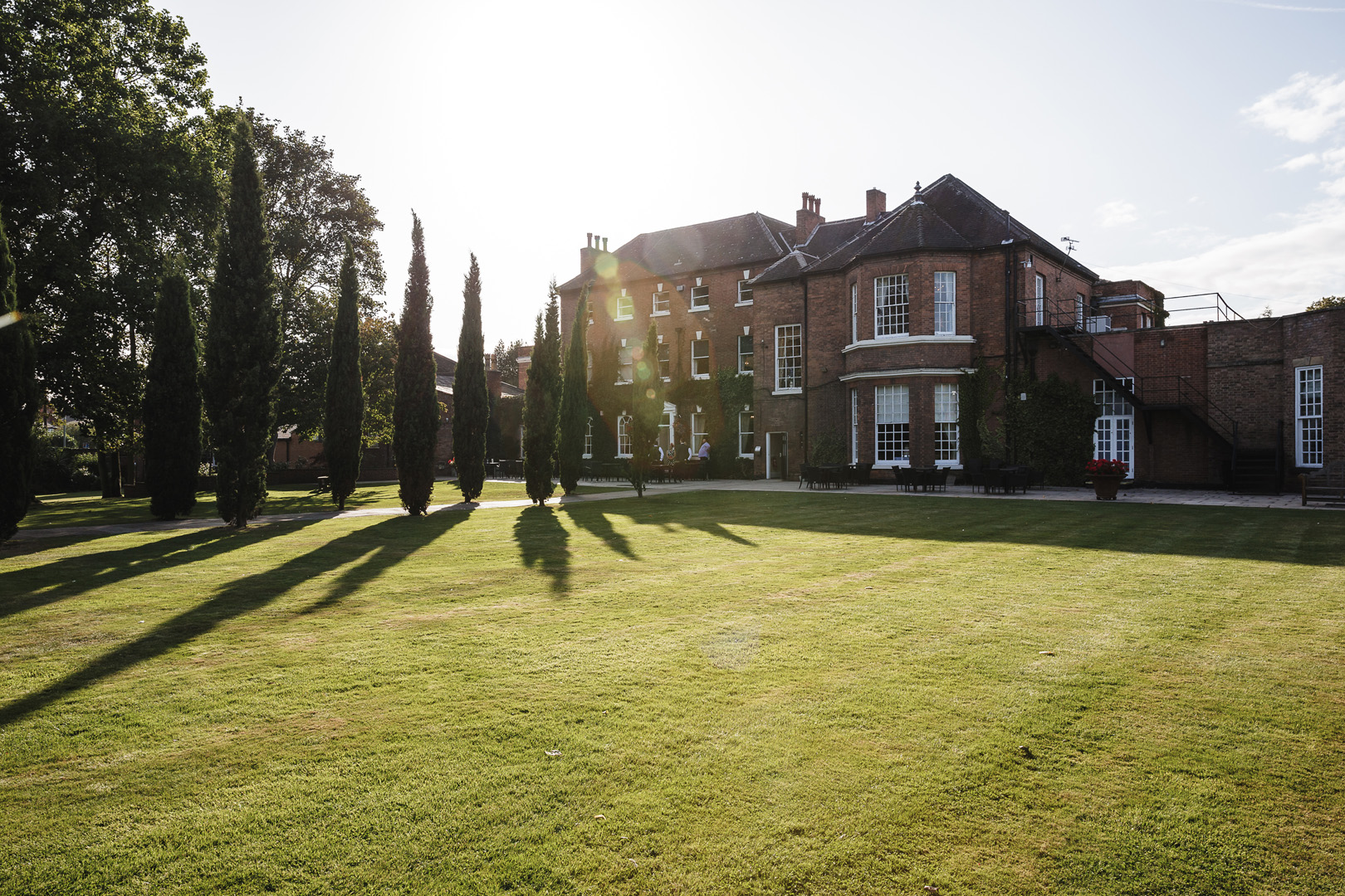 Sun shining across the gardens for this west retford hotel wedding